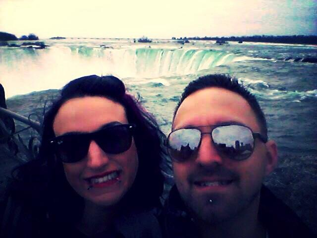 My wife and in I front of the  horseshoe Falls .... Women trying to keep a hair do is impossible, so keep it simple! haha